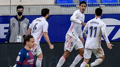 Raphael Varane is congratulated by team-mates after scoring against Huesca