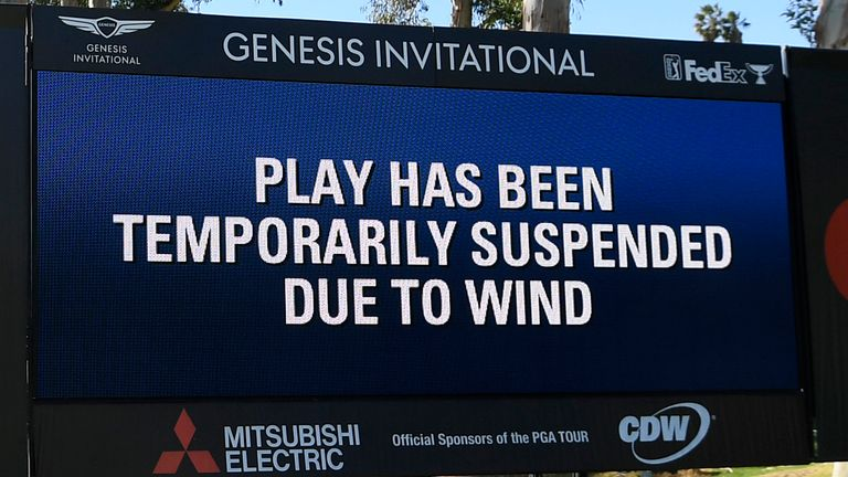 Play was stopped for three hours and 54 minutes due to winds gusting around 40 miles per hour