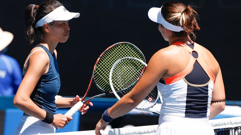 Hsieh Su-Wei (left) is congratulated at the net by Andreescu