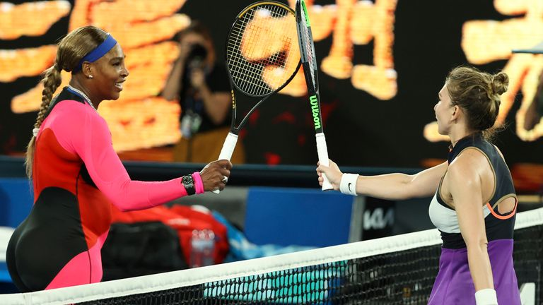 Williams (left) receives congratulations at the net from Halep