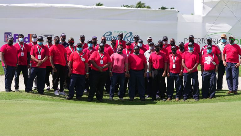 The maintenance crew in Puerto Rico all in red and black as a tribute to Woods