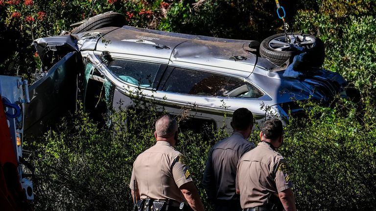 Tiger Woods rolled his car early on Tuesday morning