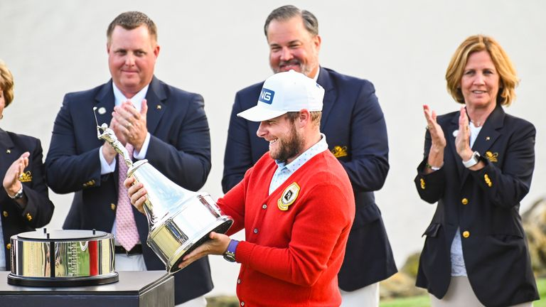 Hatton smiles as he holds the trophy following his one-stroke victory in the Arnold Palmer Invitational last year