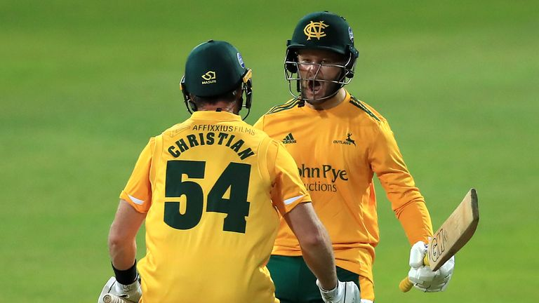 Notts Outlaws' Dan Christian (L) and Ben Duckett celebrate their side's victory at the 2020 Vitality Blast Finals Day, which was a rain-affected affair