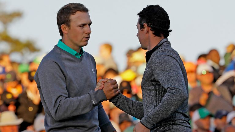 Jordan Spieth shakes hands with McIlroy on the 18th green during the third round of the 2016 Masters