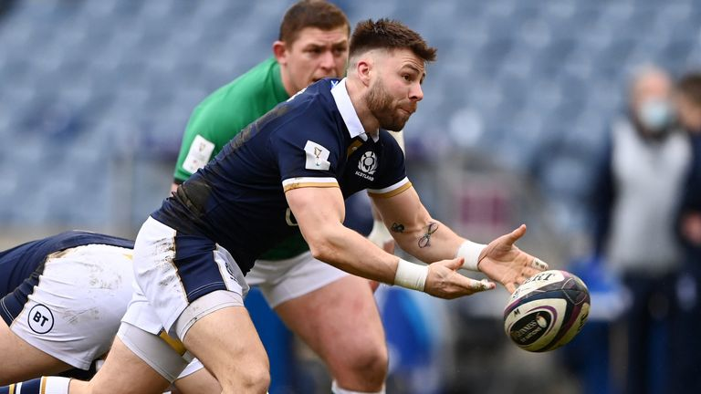 Ali Price passes the ball as Tadhg Furlong watches on