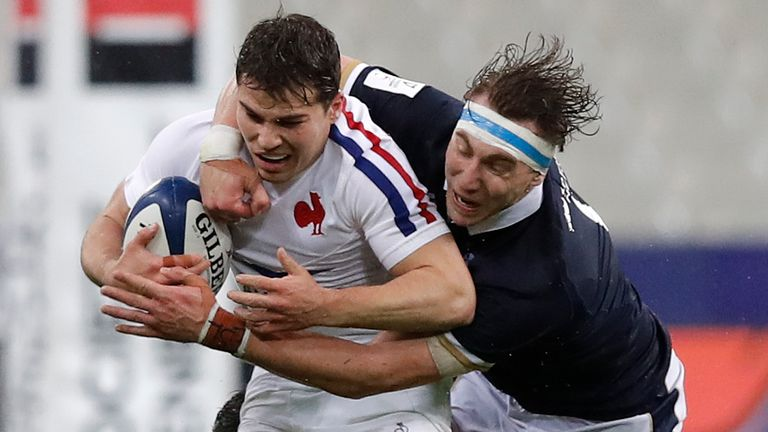 Antoine Dupont is tackled by Scotland flanker Jamie Ritchie
