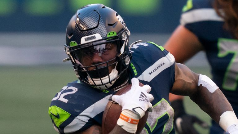 Where will Chris Carson be playing his football in 2021? (AP Photo/Stephen Brashear)