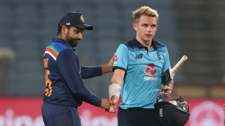 Rohit Sharma commiserates with Sam Curran after India triumphed by seven runs to seal the ODI series 2-1 in Pune