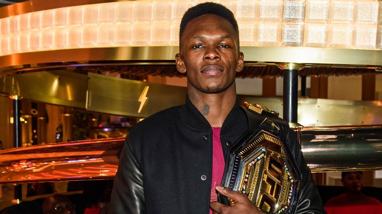 Israel Adesanya has apologised after he said he would 'rape' fellow fighter Kevin Holland
