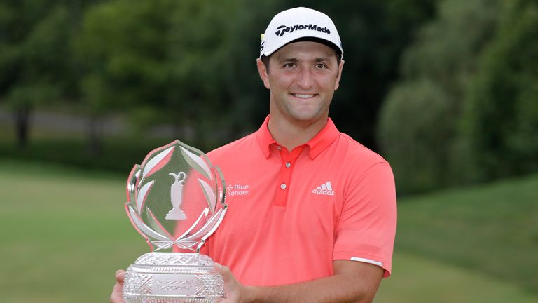 Jon Rahm poses with the trophy after winning The Memorial