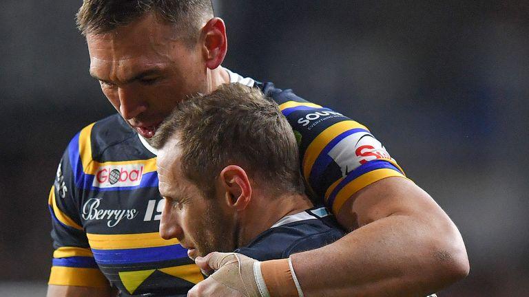 Kevin Sinfield (left) hugs former Leeds Rhinos teammate Rob Burrow