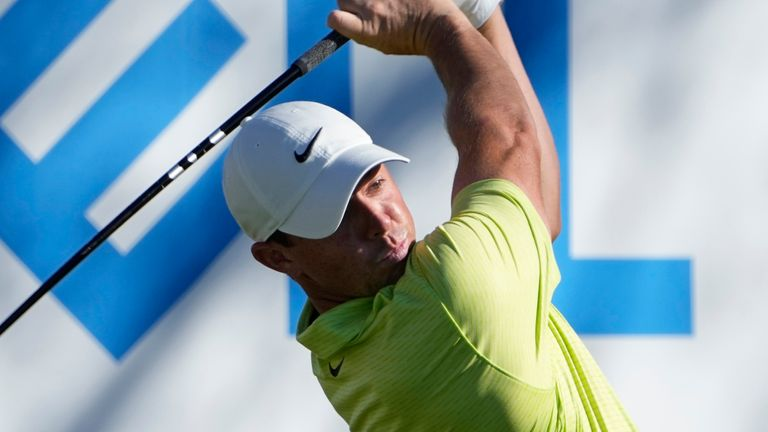 Rory McIlroy stayed in the World Match Play tournament with victory over Lanto Griffin