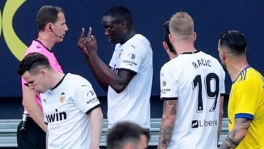 Valencia's Mouctar Diakhaby speaks to the referee following an alleged racist insult from Cadiz defender Juan Cala (unseen)