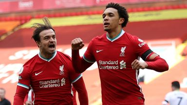 Liverpool's Trent Alexander-Arnold celebrates with team-mate Xherdan Shaqiri after scoring the winner against Aston Villa