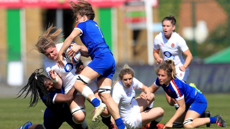 England's Poppy Cleall is tackled by France's Madoussou Fall (left)