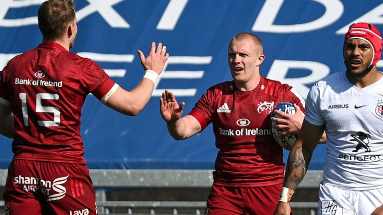 Keith Earls is congratulated by Mike Haley after scoring against Toulouse