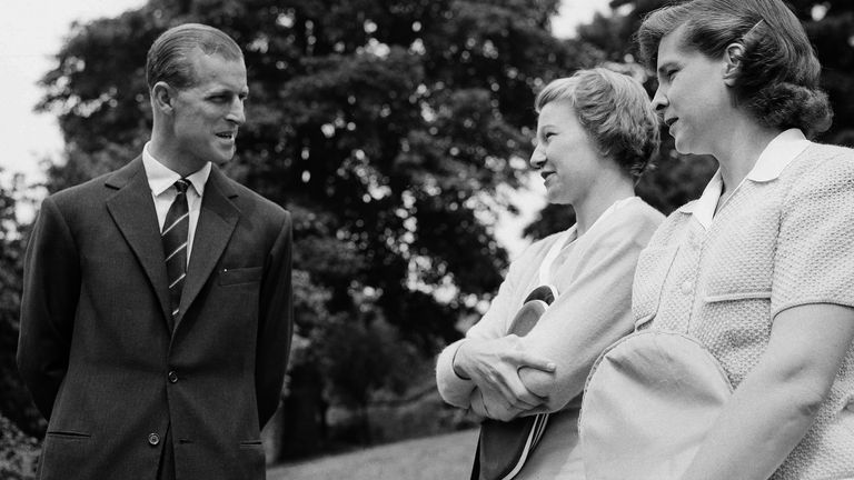 Duke of Edinburgh, Prince Philip (left) talks with US tennis players Louise Brough and Margaret duPont at a pre-Wimbledon garden party in 1949