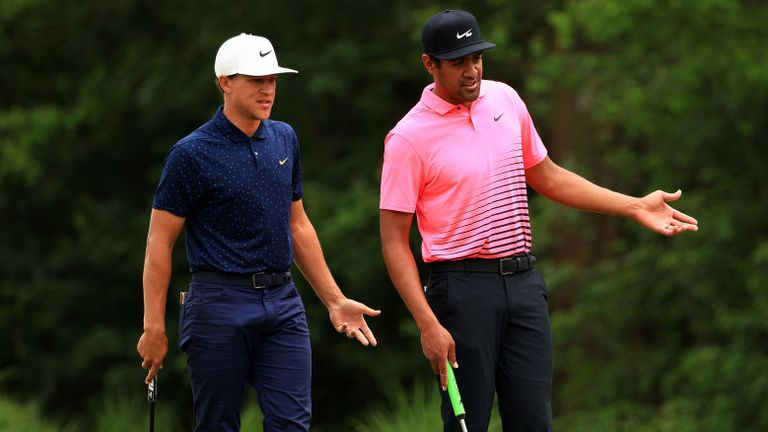 Tony Finau and Cameron Champ talk over a shot on the fourth green on their way to a 68 in the second round