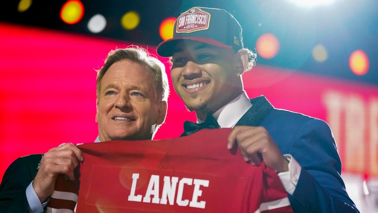 Trey Lance, right, holds up a San Francisco 49ers jersey with NFL commissioner Roger Goodell after being drafted