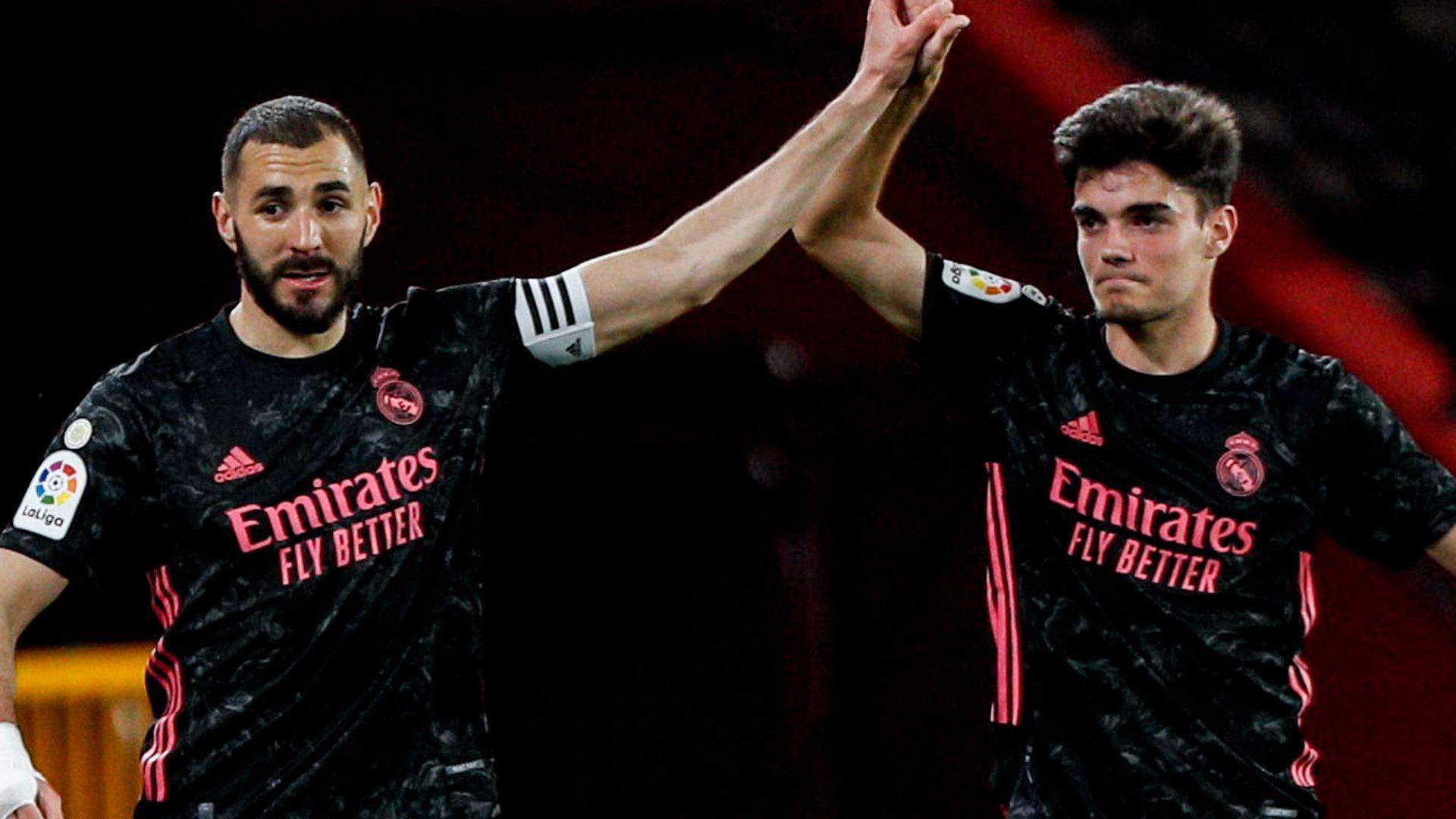 Real see off Granada as La Liga title race heats up