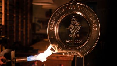 Ajax melted down the Eredivisie trophy to create mementos for their supporters