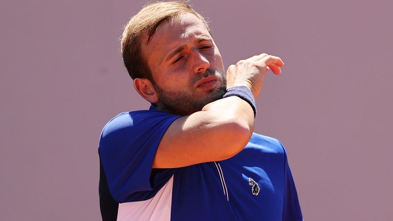 Dan Evans' search for a first French Open victory goes on after he suffered an early exit in Paris on Sunday