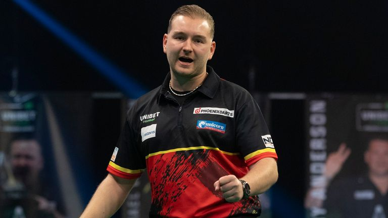Dimitri Van den Bergh got the better of table topper Nathan Aspinall to open up the battle for top spot in the 2021 Premier League (Picture: Lawrence Lustig)
