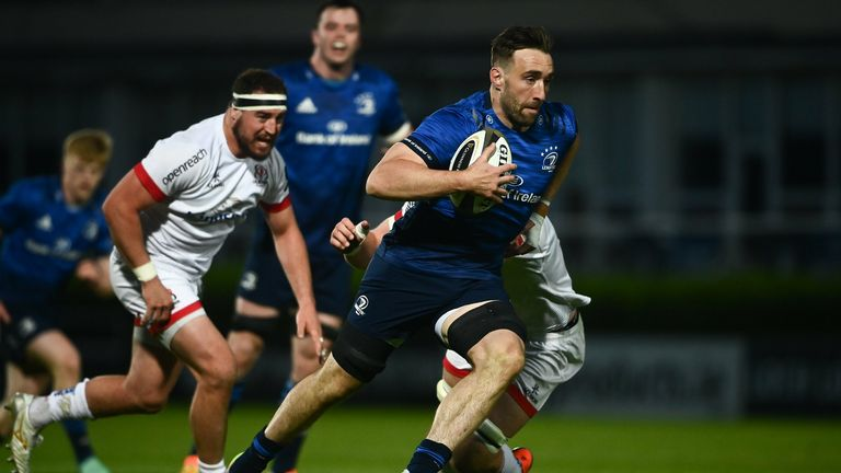 Jack Conan of Leinster evades the tackle from Iain Henderson