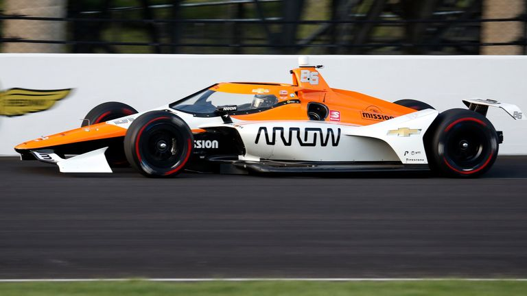 Montoya in testing action at Indy last month. He'll be driving the below red and black branded car in the Indy GP this weekend.