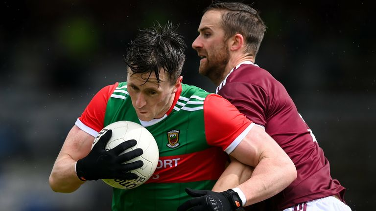 Cillian O'Connor of Mayo is tackled by Kevin Maguire of Westmeath
