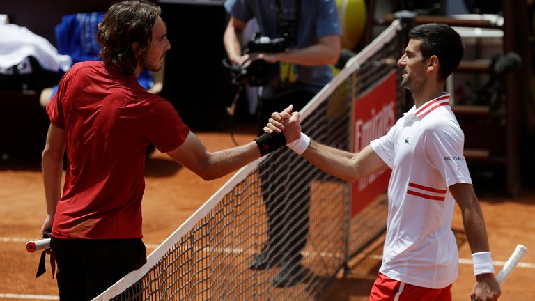 Djokovic (right) and Tsitsipas shake hands at the net after a gladiatorial battle in Rome