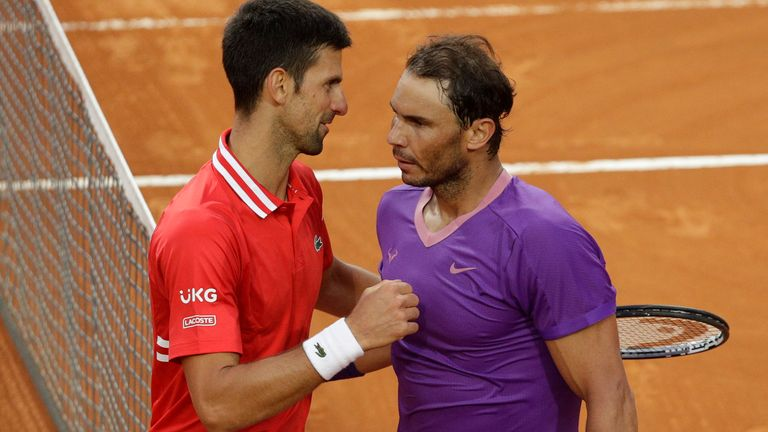 Nadal (right) is now just one behind Djokovic, who leads their head-to-head record 29-28 heading into Roland Garros