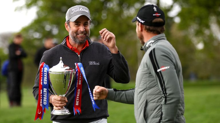 Bland is greeted by tournament host Danny Willett after winning the Betfred British Masters