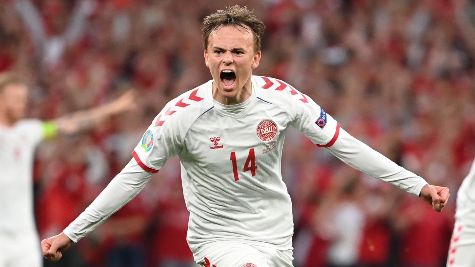 Emotional Denmark thrash Russia to face Wales in last 16