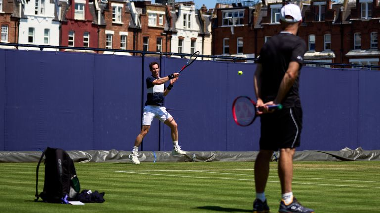 Murray's current coach Jamie Delgado watches the Scot in practice at Queen's Club