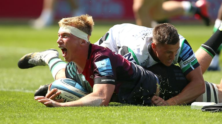 Harlequins' Jack Kenningham celebrates after scoring the opening try of the game against Newcastle