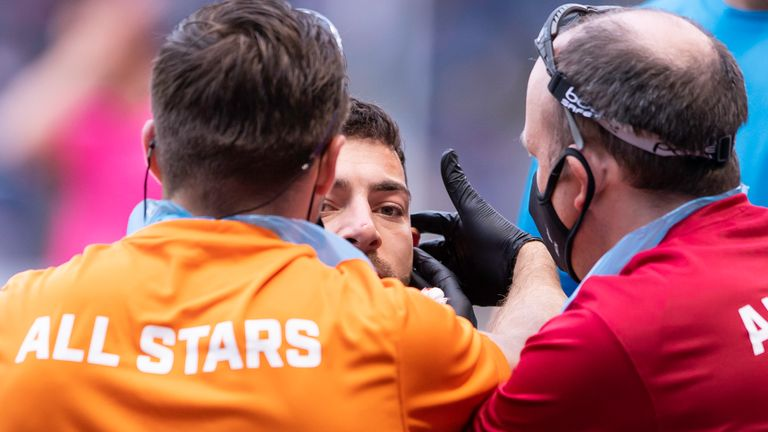 All Stars Jake Connor is attended to after an injury.