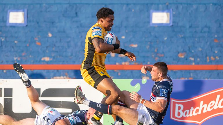 Jordan Turner fights through Wakefield's defences to score a try
