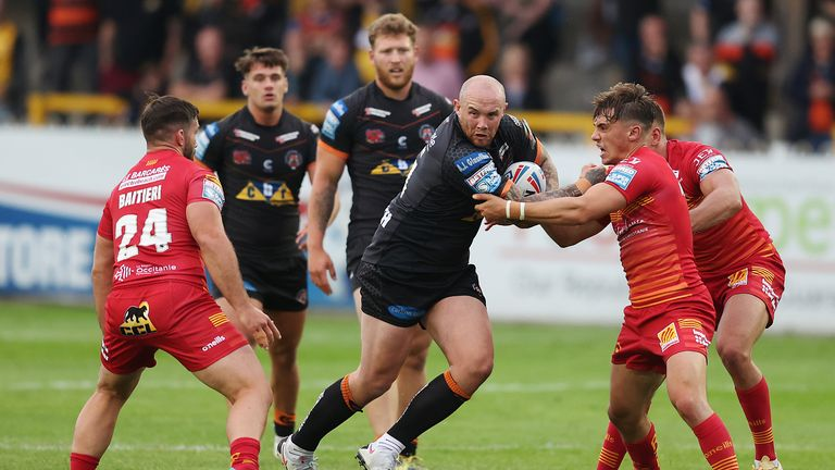 Castleford Tigers' Nathan Massey in action with Catalans Dragons' Arthur Mourgue and Jason Baitieri