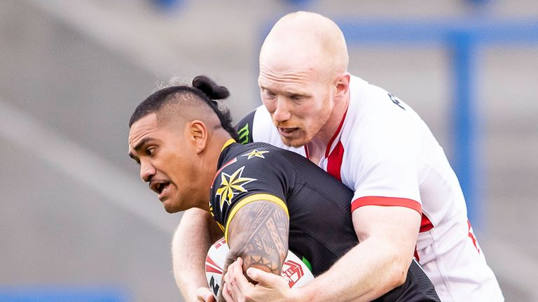 All Stars Peter Mata'utia is tackled by England's Liam Farrell.