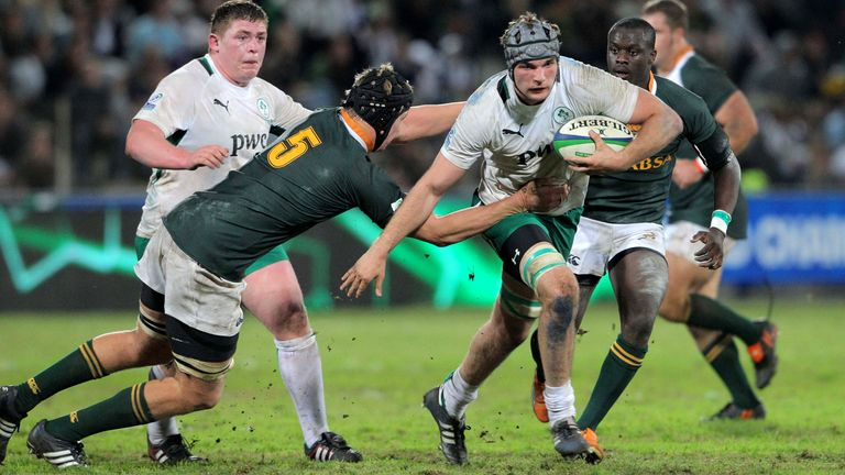 Beirne is tackled by Pieter-Steph du Toit with Tadhg Furlong in support during the Under 20 match between South Africa and Ireland in Stellenbosch