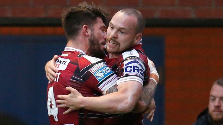 Liam Marshall celebrates scoring Wigan's first try