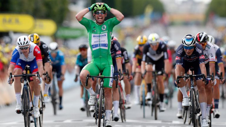 Cavendish celebrates as he crosses the finish line to win in Chateauroux, France