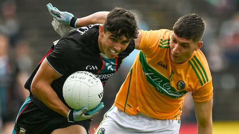 Tommy Conroy of Mayo in action against Conor Dolan of Leitrim
