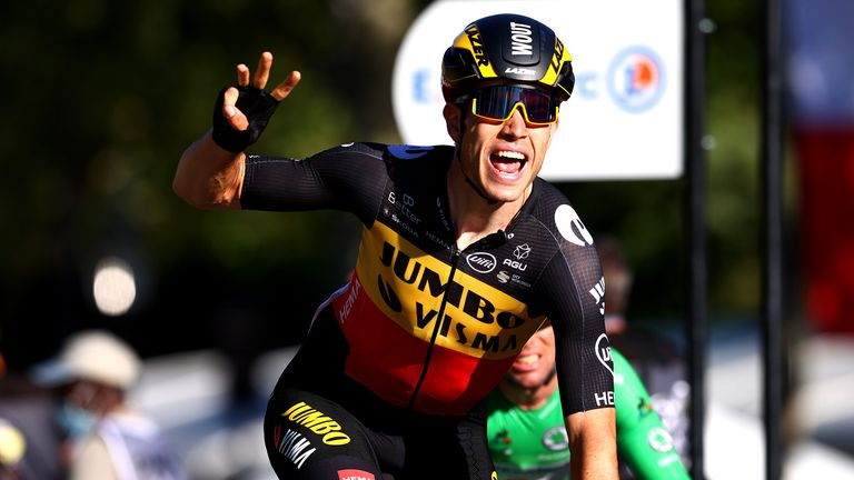 Wout Van Aert of Belgium celebrates winning Stage 21