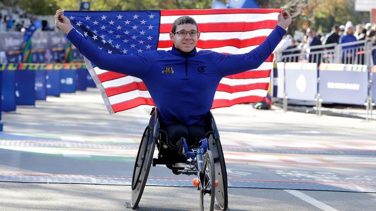 Daniel Romanchuk celebrates his victory in the men's wheelchair race at the New York marathon in 2019