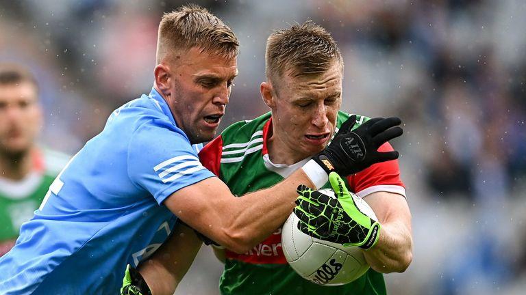 Jonny Cooper of Dublin in action against Ryan O'Donoghue of Mayo