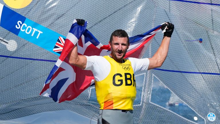 Britain's Giles Scott celebrates after placing first in the men's Finn medal race