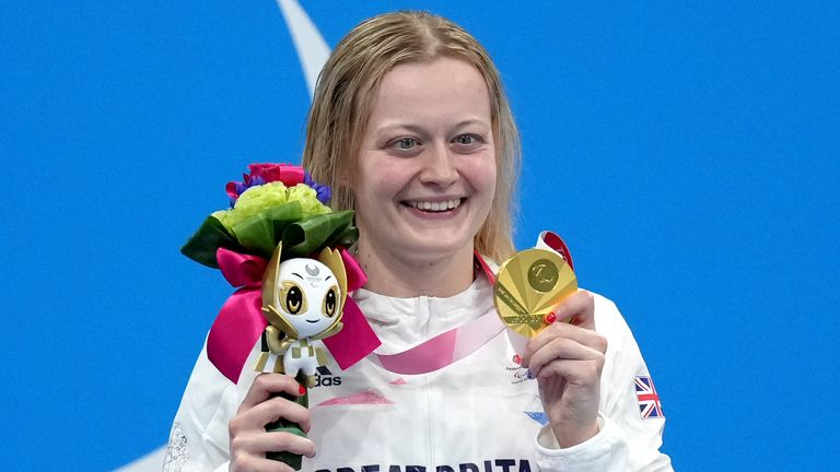 Russell celebrates on the podium after receiving her Paralympics gold medal